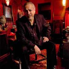 """Sam Llanas (formerly of the BoDeans) is an iconic American singer, acoustic guitarist, and songwriter. Best known for his unique and distinctively soulful voice, Sam's fiery vocals fueled many of his former band's finest songs including their biggest hit """"Closer To Free."""" It was Llanas'…"""